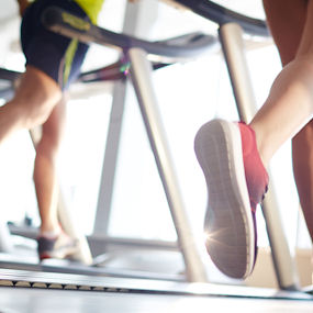 Images of legs running on a treadmill