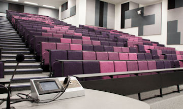 Inside of University lecture theatre showing the purple seats