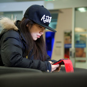 Young Asian woman sat at her laptop working